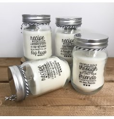 An assortment of 4 small candles in glass jars with sayings