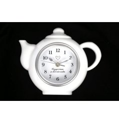A charming decorative wall clock set with teapot shape and added scripted text decal