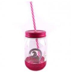 A stylish pink glittered mason jar finished with a pink striped straw and silver unicorn print