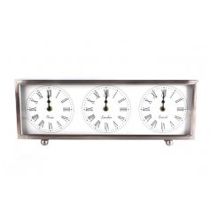 A stylish modernised triple face clock in a chrome looking finish