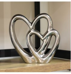A chic silver double heart ornament. A classic and popular decorative.