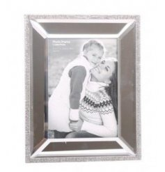 A large sparkly mirrored photo frame