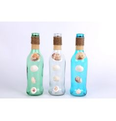 A mix of 3 decorative glass bottles with shells. A chic seasonal accessory.