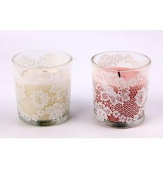 A mix of 2 pretty scented candles, each with a lace design.