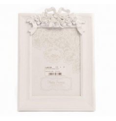 Beautifully simple square photo frame complete with a rustic edging, finished with a detailed floral bow on the top