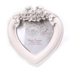 A pretty heart shaped photo frame with an ornate bow and floral design.