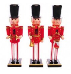 An assortment of 3 wooden nutcracker decorations