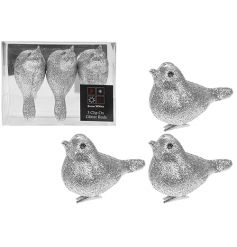 A set of 3 silver glitter birds with clip. Ideal for displaying on your tree and garlands.