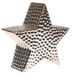 A 3D star decoration in rose gold. A chic interior ornament.