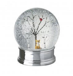 We all love a snow globe at Christmas, especially one with an adorable fox ornament and twig trees.