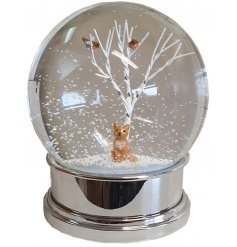 A charming large snow globe with an adorable fox figure sat within woodland trees. Complete with a festive red robin!