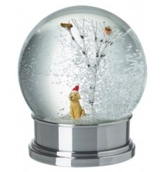 Fallen in love yet? An adorable golden labrador figure with a red Christmas hat sat politely in a woodland scene.