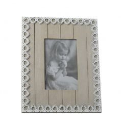 A pretty shabby chic and vintage inspired photo frame with a pretty white lace heart pattern.