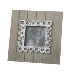 A pretty square photo frame with a white heart shaped lace pattern.