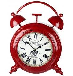A large red vintage metal clock