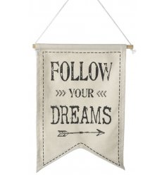 A pretty fabric banner with a 'follow your dreams' slogan. Perfect for home and event decor.