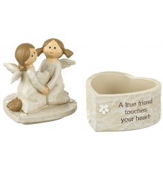 A heart shaped trinket box with twin kneeling angels and a lovely friendship slogan.