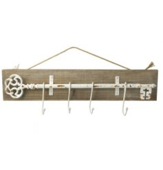 A distressed styled coat hook with a rustic key theme