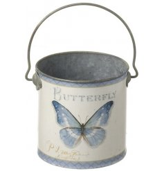 A pretty botanical butterfly design bucket with handle. A lovely Spring planter and multi-purpose storage item.