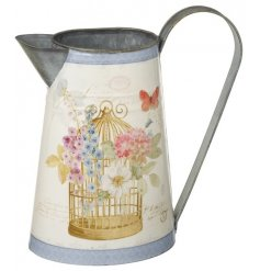 A pretty zinc jug with a beautiful birdcage and floral design.