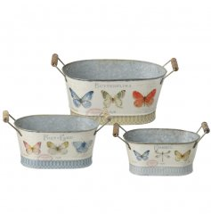 A set of 3 zinc trough shaped planters with wooden handles and a beautiful butterfly design.