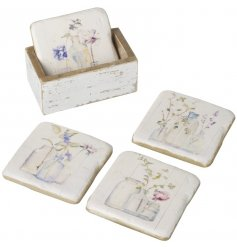A set of 4 coasters with a beautiful watercolour style floral design.