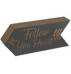 A scripted black and gold wooden arrow sign