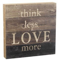 A rustic wooden panel sign with a sentiment LOVE slogan.