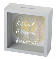 A beautiful pastel toned wooden money box, perfect for saving up the funds for your first home!