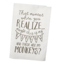 A soft cotton based tea towel with a comical script style quote