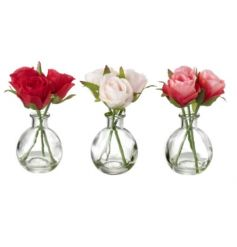 A sweet assortment of bunched roses in a little glass pot,