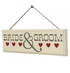 "A quirky little wooden plaque with a script ""Bride&Groom"""