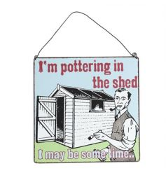 A vintage design metal sign with a pottering in the shed slogan.