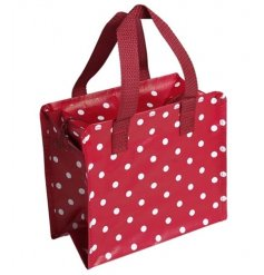 A red and white polkadot design charlotte bag made from recycled plastic bottles. Complete with a zip fastening.