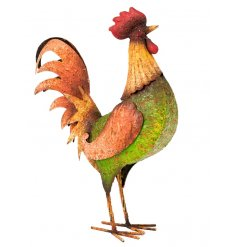 A rustic painted metal cockerel garden figure