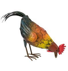 A metal pecking cockerel garden figure