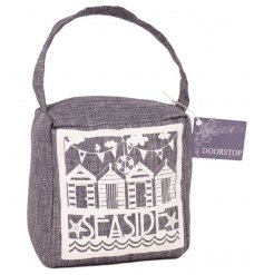 Made from a neutral grey coloured fabric, this hard wearing doorstop is is the perfect piece for any coastal themed roo