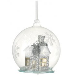 A decorative glass bauble with a sparkling silver LED house centre