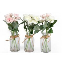 A delightful mix of glass jars filled with artificial rose blooms and buds