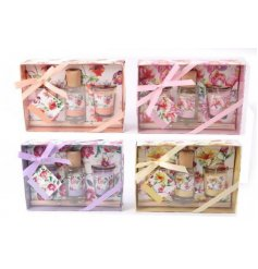 An assortment of 4 pretty floral scented gift sets including two candles and a reed diffuser.