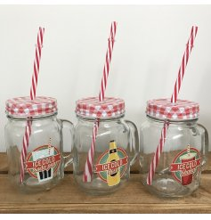 An assortment of 3 retro glass drinking mason jars