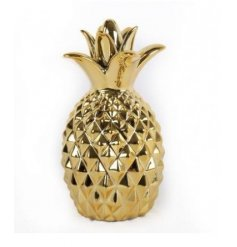 A stylish gold pineapple ornament. A must have decorative accessory for the home.