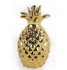 A glamorous gold pineapple ornament. A chic and on trend decoration for the home.