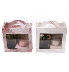 A sweet smelling set of scented candles and artificial flowers