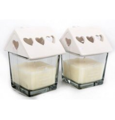 A sweetly designed square candle finished with a ceramic white roof to make it look like a cozy home