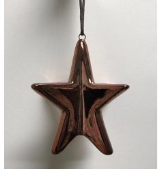 A shiny 3D hanging star made form a strong ceramic and coated a smooth copper paint,