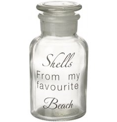 A small glass jar with shells from my favourite beach bottle