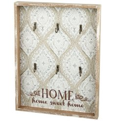 A wooden home sweet home key hanger