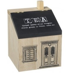 A wooden tea caddy in the style of a house