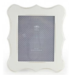 A stylish all white wooden picture frame,